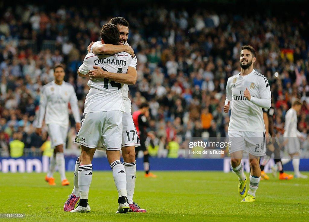Alvaro Arbeloa (L) and Chicharito Hernandez of Real Madrid celebrate after scoring during the La Liga match between Real Madrid CF and UD Almeria at Estadio Santiago Bernabeu on April 29, 2015 in Madrid, Spain.