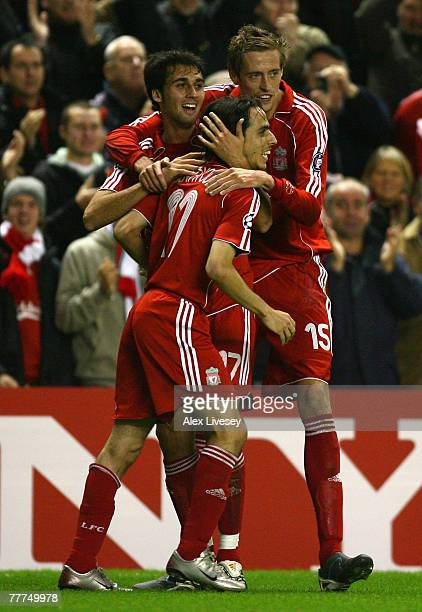 Alvaro Arbeloa and Peter Crouch congratulate team mate Yossi Benayoun of Liverpool after he scored his team's second goal during the UEFA Champions...