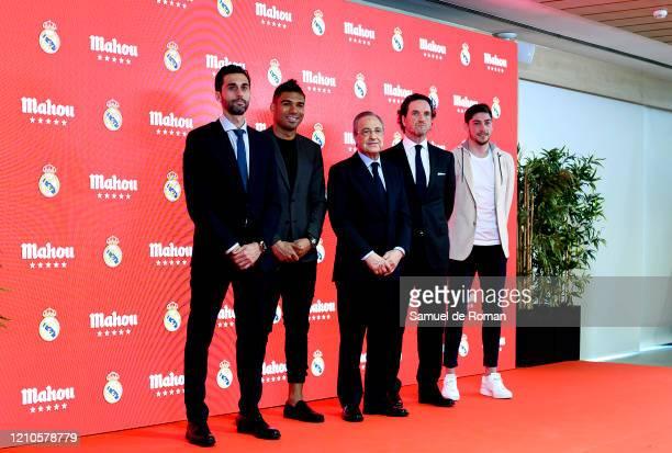 Alvaro Arbeloa, Carlos Henrique Casemiro, Florentino Perez, Eduardo Petrossi and Federico Valverde pose for photo during the signing of the...
