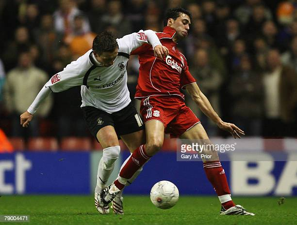 Alvaro Arbeloa of Liverpool and Darren Currie of Luton battle for the ball during the FA Cup 3rd round replay sponsored by EON match between...