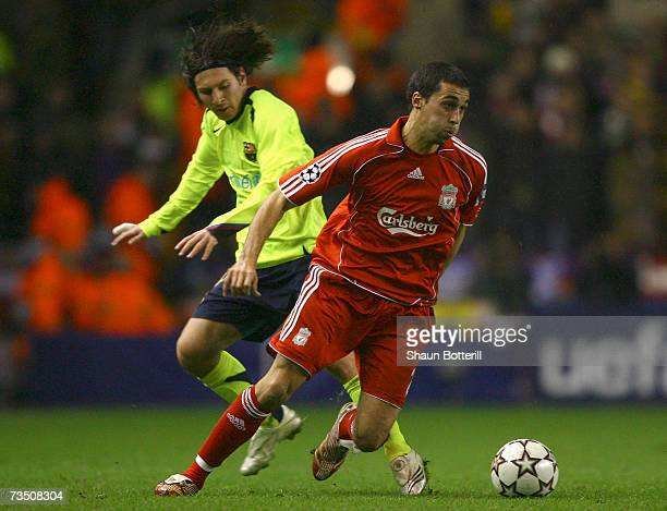 Alvaro Arbeloa of Liverpool sterrs the ball away from Lionel Messi of Barcelona during the UEFA Champions League round of sixteen second leg match...