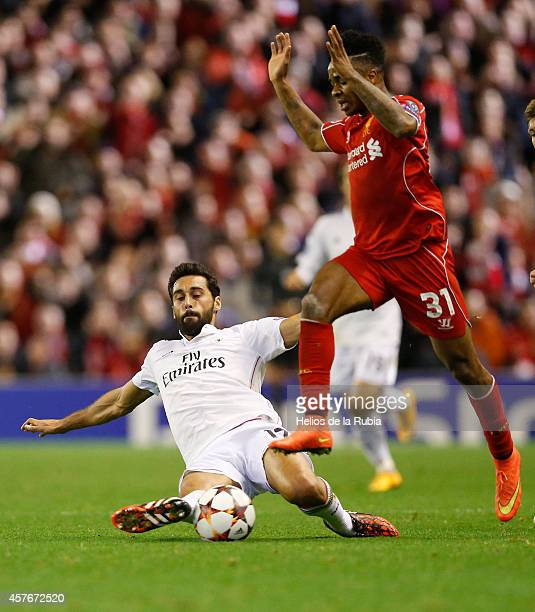 Alvaro Arbeloa of Real Madrid and Raheem Sterling of Liverpool compete for the ball during the mach Liverpool and Real Madrid on October 22 2014 in...