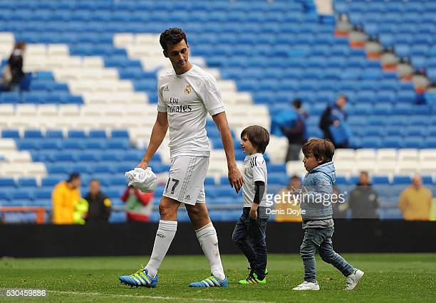 Alvaro Arbeloa of Real Madrid brings his children onto the pitch after his last match for Real Madrid in the La Liga match between Real Madrid CF and...