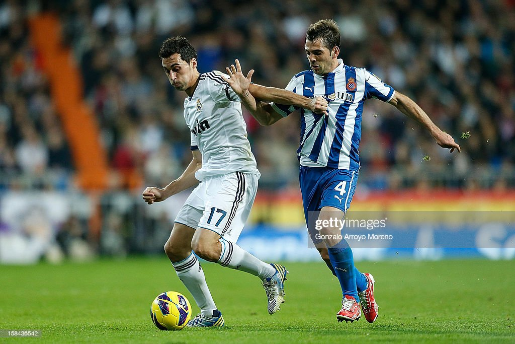 Alvaro Arbeloa (L) of Real Madrid CF competes for the ball with Victor Sanchez of RCD Espanyol during the La Liga match between Real Madrid CF and RCD Espanyol at Estadio Santiago Bernabeu on December 16, 2012 in Madrid, Spain.