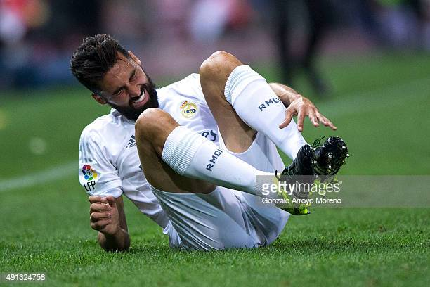 Alvaro Arbeloa of Real Madrid CF grimmaces in pain during the La Liga match between Club Atletico de Madrid and Real Madrid CF at Vicente Calderon...