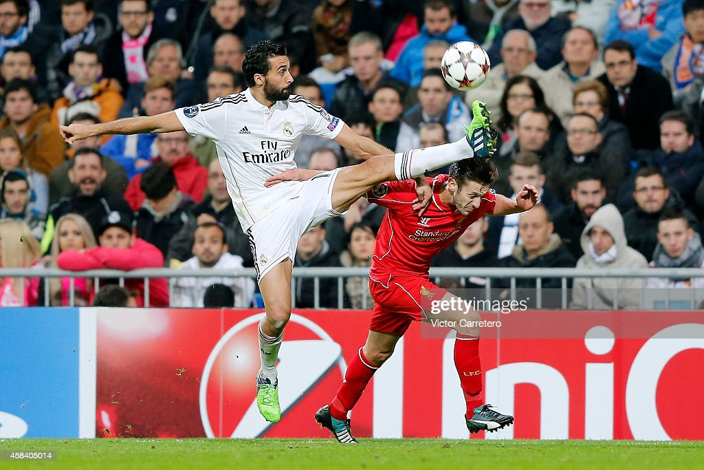 Alvaro Arbeloa (L) of Real Madrid competes for the ball with Adam Lallana of Liverpool during the UEFA Champions League Group B match between Real Madrid CF and Liverpool on November 4, 2014 in Madrid, Spain.