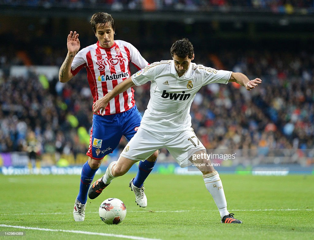 Alvaro Arbeloa (R) of Real Madrid duels for the ball with Oscar Trejo of Real Sporting de Gijon during the La Liga match between Real Madrid CF and Real Sporting de Gijon at the Estadio Santiago Bernabeu on April 14, 2012 in Madrid, Spain.