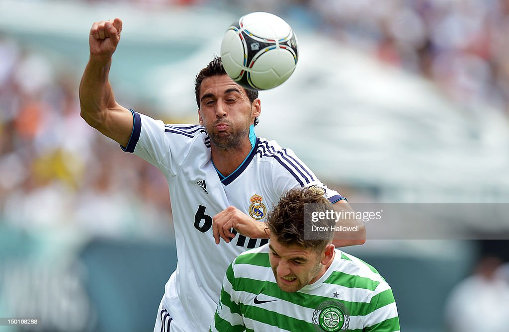 Alvaro Arbeloa #17 of Real Madrid goes over the top of Charlie Mulgrew #21 of Celtic to head the ball at Lincoln Financial Field on August 11, 2012 in Philadelphia, Pennsylvania.