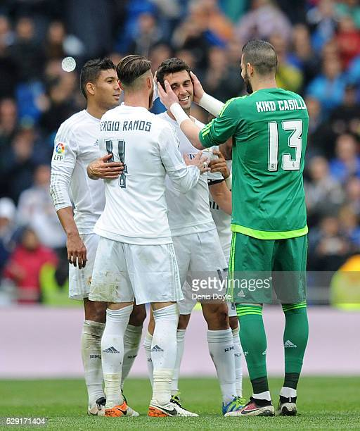 Alvaro Arbeloa of Real Madrid is congratulated by Kiko Casilla after playing his last match for Real during the La Liga match between Real Madrid CF...