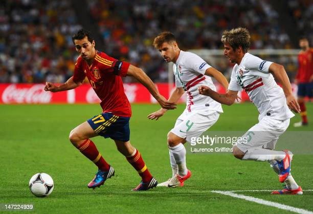 Alvaro Arbeloa of Spain is pursued by Miguel Veloso and Fabio Coentrao of Portugal during the UEFA EURO 2012 semi final match between Portugal and...