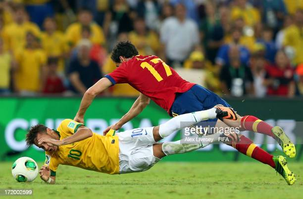 Alvaro Arbeloa of Spain tangles with Neymar of Brazil during the FIFA Confederations Cup Brazil 2013 Final match between Brazil and Spain at Maracana...