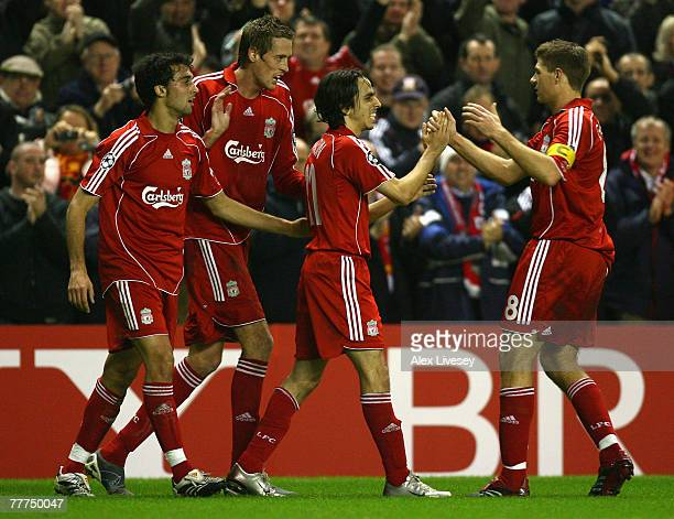 Alvaro Arbeloa Peter Crouch and Steven Gerrard congratulate team mate Yossi Benayoun of Liverpool after he scored his team's second goal during the...