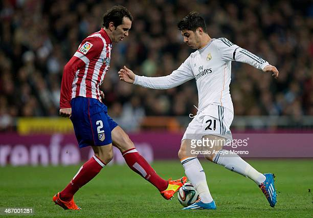 Alvaro B Morata of Real Madrid CF competes for the ball with Diego Godin of Atletico de Madrid during the Copa del Rey semifinal first leg match...