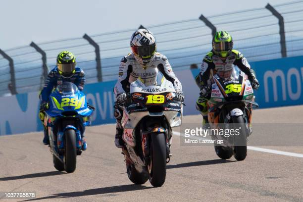 Alvaro Bautista of Spain and Angel Nieto Team and Cal Crutchlow of Great Britain and LCR Honda return in box during the qualifying practice during...