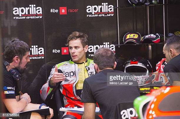 Alvaro Bautista of Spain and Aprilia Racing Team Gresini speaks in box during the MotoGP Tests In Doha at Losail Circuit on March 4 2016 in Doha Qatar