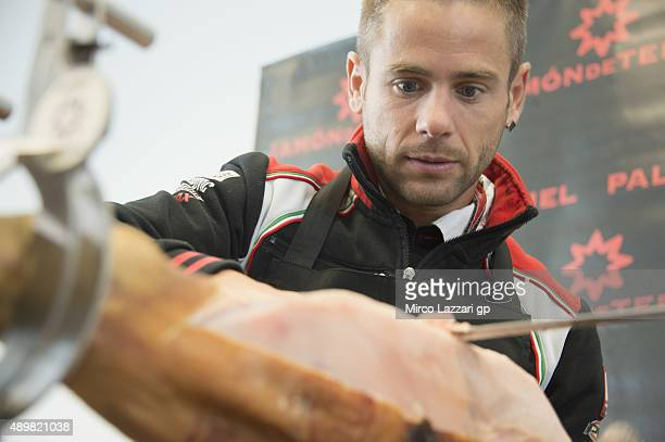 Alvaro Bautista of Spain and Factory Aprilia Gresini cuts jamon during the preevent Iberian Ham Carving Master class guided MotoGP riders will learn...