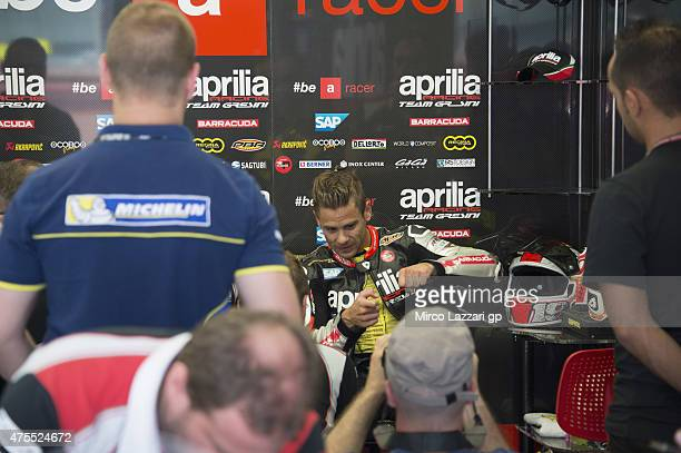 Alvaro Bautista of Spain and Factory Aprilia Gresini speaks with mechanics during the Michelin tires test during the MotoGp Tests At Mugello at...