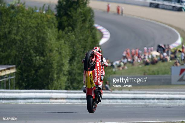 Alvaro Bautista of Spain and Mapfre Aspar Team crashes out while attempting a wheelie after finishing the 250cc race in third place in the MotoGP...