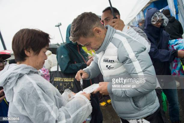 Alvaro Bautista of Spain and PullBear Aspar Team signs autographs for fans during the MotoGP of Japan Free Practice at Twin Ring Motegi on October 13...