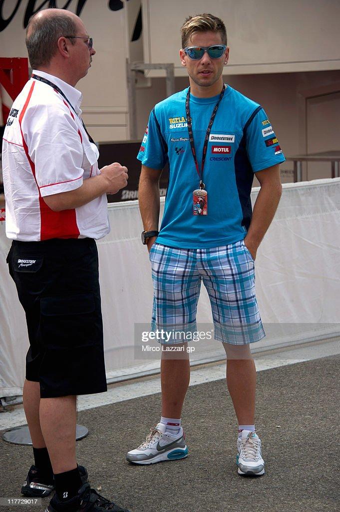 Alvaro Bautista of Spain and Rizla Suzuki MotoGP speaks in the paddock during the MotoGp of Italy at Mugello Circuit on June 30, 2011 in Scarperia near Florence, Italy.