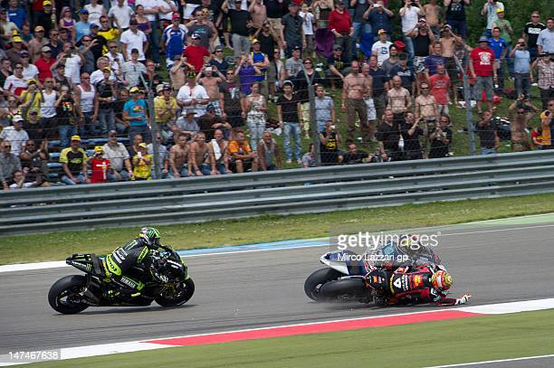 Alvaro Bautista of Spain and San Carlo Honda Gresini and Jorge Lorenzo of Spain and Yamaha Factory Team crashed out during the MotoGP race of the...