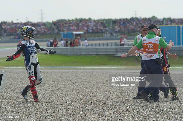 Alvaro Bautista of Spain and San Carlo Honda Gresini and Jorge Lorenzo of Spain and Yamaha Factory Team after crashed out during the MotoGP race of...