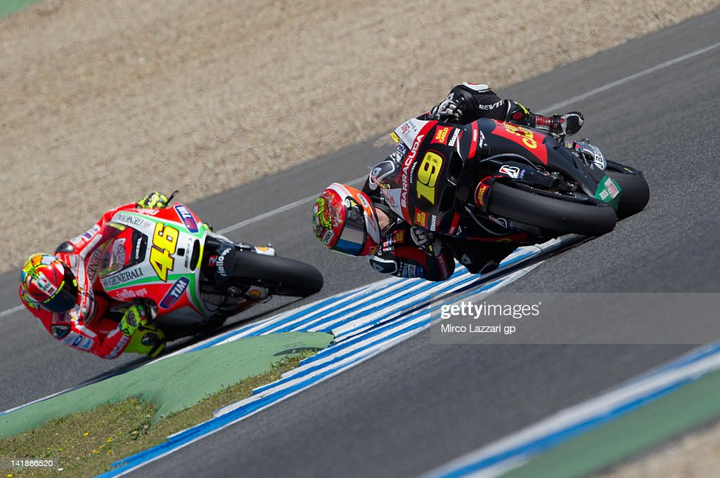 Alvaro Bautista of Spain and San Carlo Honda Gresini leads Valentino Rossi of Italy and Ducati Marlboro Team during the third day of testing of MotoGP Tests In Jerez at Circuito de Jerez on March 25, 2012 in Jerez de la Frontera, Spain.