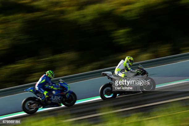Alvaro Bautista of Spain and the PullBear Aspar Team rides ahead of Andrea Iannone of Italy and Team SUZUKI ECSTAR during final practice for the...