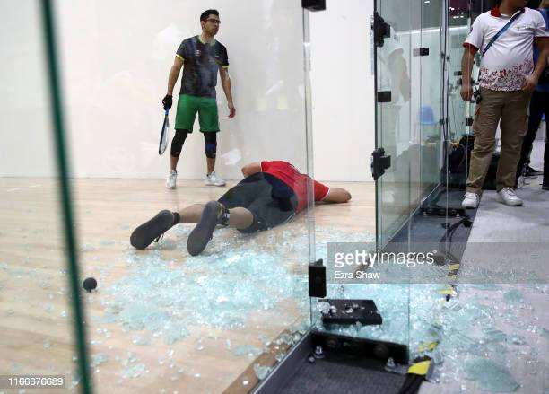 Alvaro Beltran of Mexico lies on the court after he collided and smashed the glass wall during his match against Rodrigo Montoya of Mexico in the...