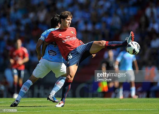 Alvaro Cejudo of CA Osasuna battles for the ball against Miguel Flano of RC Celta de Vigo during the La Liga match between RC Celta de Vigo and CA...