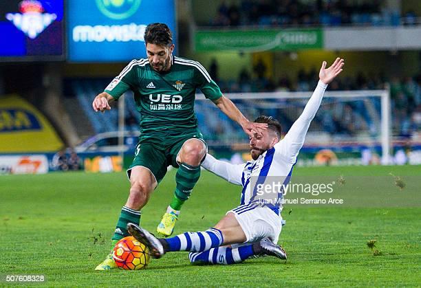 Alvaro Cejudo of Real Betis Balompie duels for the ball with Hector Hernandez of Real Sociedad during the La Liga match between Real Sociedad de...