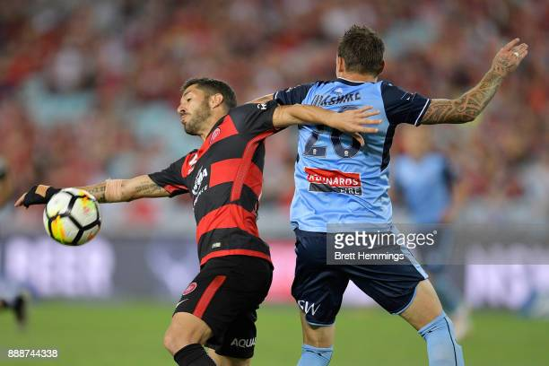 Alvaro Cejudo of the Wanderers and Aleksander Cisak of Sydney contest the ball during the round 10 ALeague match between the Western Sydney Wanderers...