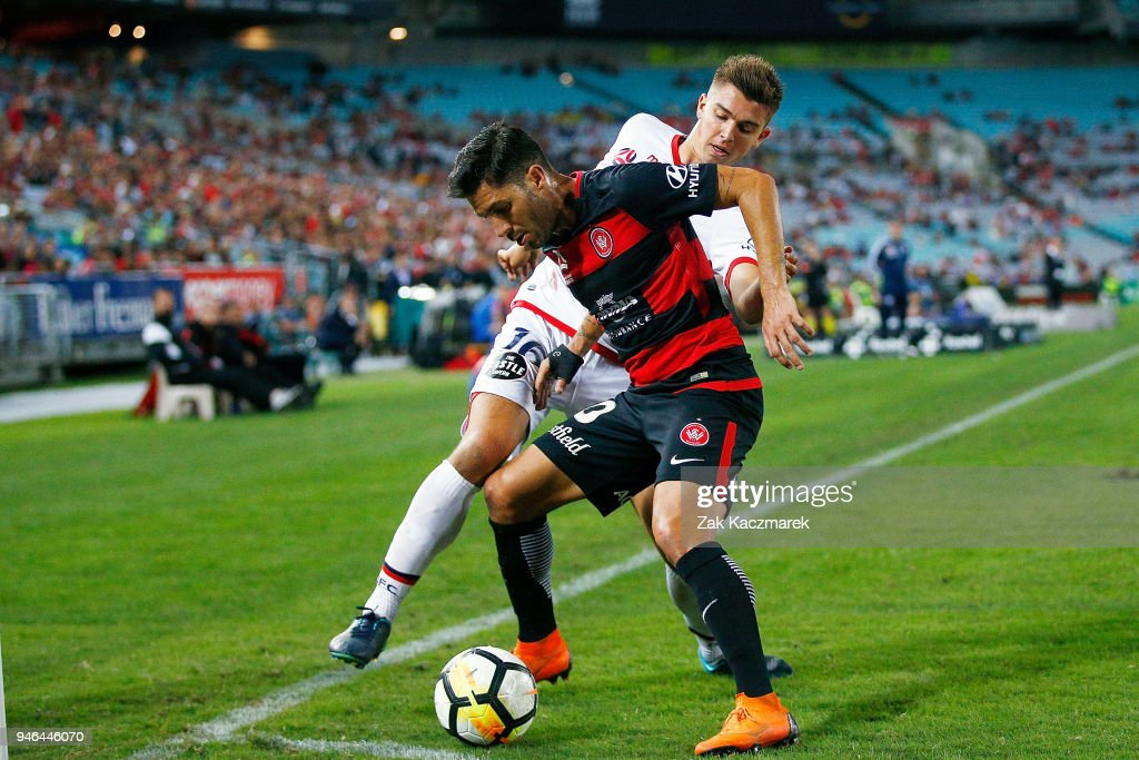 Alvaro Cejudo of the Wanderers is challenged by Nathan Konstandopoulos of Adelaide during the round 27 A-League match between the Western Sydney Wanderers and Adelaide United at ANZ Stadium on April 15, 2018 in Sydney, Australia.