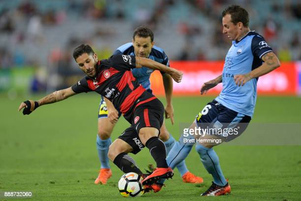 Alvaro Cejudo of the Wanderers is tackled during the round 10 ALeague match between the Western Sydney Wanderers and Sydney FC at ANZ Stadium on...