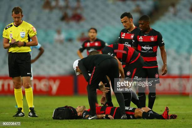 Alvaro Cejudo of the Wanderers lays on the ground injured during the round 13 ALeague match between the Western Sydney Wanderers and Melbourne City...