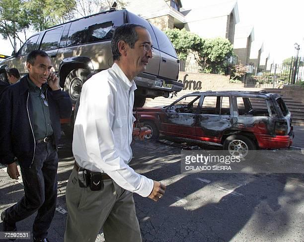 Alvaro Colom candidato presidencial por el opositor Unidad Nacional de la Esperanza observa los destrozos causados durante el atentado contra su...