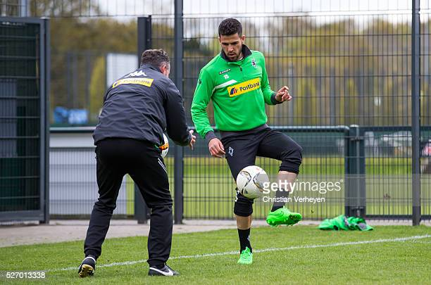 Alvaro Dominguez and Physiotherapist Andreas Bluhm of Borussia Moenchengladbach during a Training Session of Borussia Moenchengladbach at...