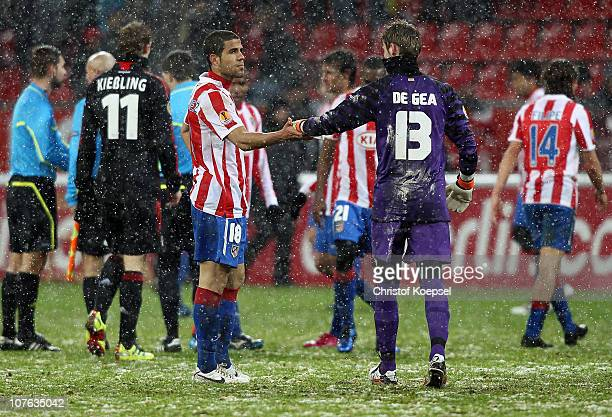 Alvaro Dominguez of Atletico and David de Gea of Atletico looks dejected after the 11 draw of the UEFA Europa League Group B match between Bayer...