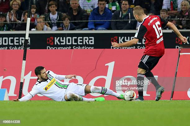 Alvaro Dominguez of Borussia Moenchengladbach and Lukas Hinterseer of FC Ingolstadt battle for the ball during the Bundesliga match between Borussia...
