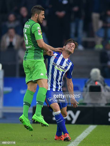 Alvaro Dominguez of Borussia Moenchengladbach and Valentin Stocker of Hertha BSC during the game between Hertha BSC and Borussia Moenchengladbach on...