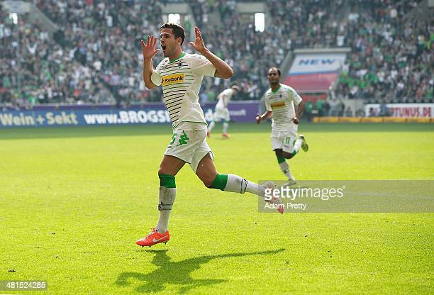 Alvaro Dominguez of Moenchengladbach celebrates after scoring a goal during the Bundesliga match between Borussia Moenchengladbach and Hamburger SV...