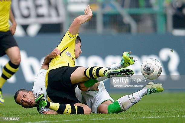 Alvaro Dominguez Soto of Borussia Moenchengladbach challenges Robert Lewandowski of Borussia Dortmund during the Bundesliga match between Borussia...