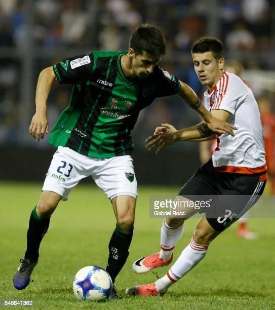 Alvaro Fernandez of San Martin fights for the ball with Tomas Andrade of River Plate during a match between San Martin de San Juan and River Plate as...