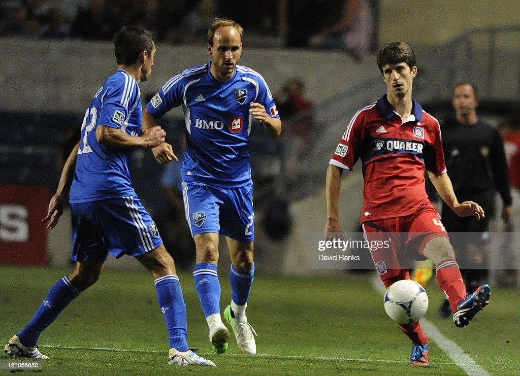 Alvaro Fernandez #4 of the Chicago Fire is defended by Justin Mapp #21of Montreal Impact and Davy Arnaud #22 in an MLS match on September 15, 2012 at Toyota Park in Bridgeview, Illinois. The Chicago Fire defeated the Montreal Impact 3-1.