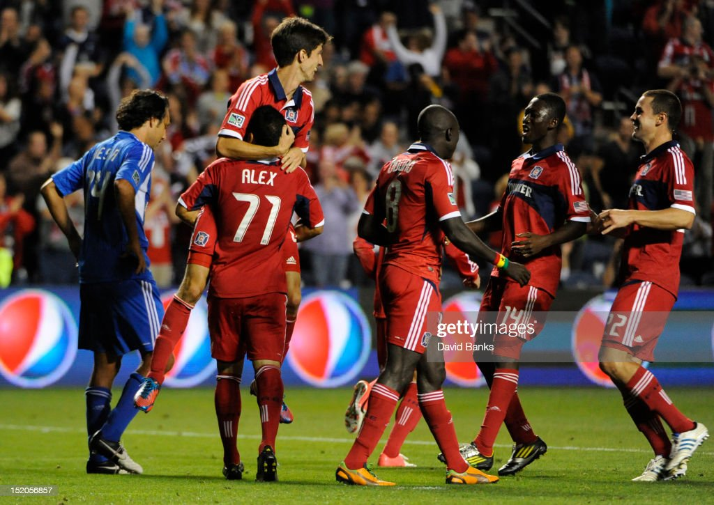 Alvaro Fernandez of the Chicago Fire #4 is lifted up by Alex #71 after scoring a goal against the Montreal Impact in an MLS match on September 15, 2012 at Toyota Park in Bridgeview, Illinois. The Chicago Fire defeated the Montreal Impact 3-1.