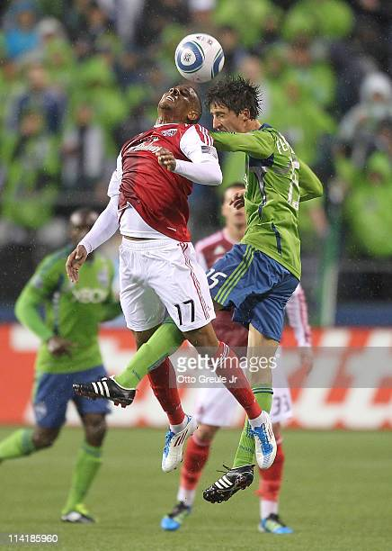 Alvaro Fernandez of the Seattle Sounders FC battles Jeremy Hall of the Portland Timbers at Qwest Field on May 14 2011 in Seattle Washington
