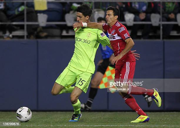 Alvaro Fernandez of the Seattle Sounders FC battles Marco Pappa of the Chicago Fire during the 2011 Lamar Hunt US Open Cup Final at CenturyLink Field...