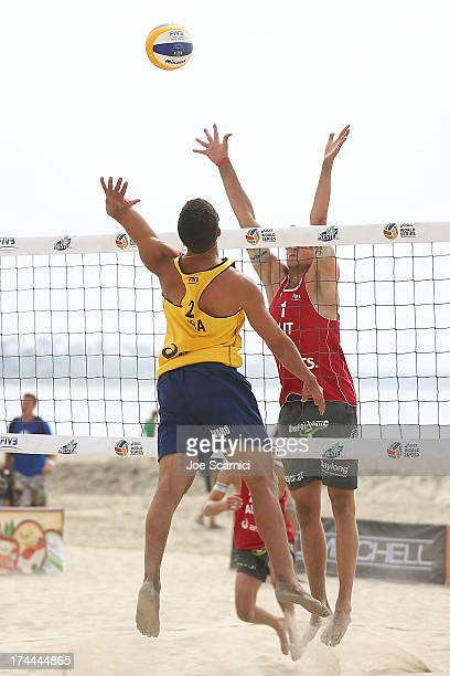 Alvaro Filho of Brazil spikes the ball over Robin Seidl of Austria during the men's pool play round at the ASICS World Series of Beach Volleyball -...