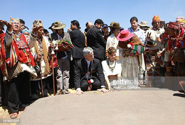 Alvaro Garcia Linera vice president of Bolivia and Claudia Fernandez pose their hands on the sacred rock for good energy during their wedding...