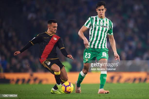 Alvaro Garcia of Rayo Vallecano competes for the ball with Aissa Mandi of Real Betis Balompie during the La Liga match between Real Betis Balompie...